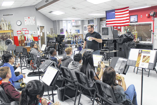 Geoffrey Tart, band director, works with students. Hobbton High School was selected to represent the state at this year's National Memorial Day Parade. File Photo   Sampson Independent