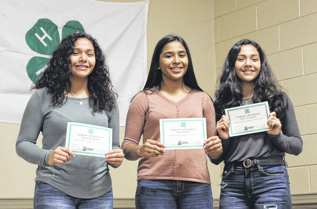 Juntos students from Hobbton High School proudly hold their certificates.