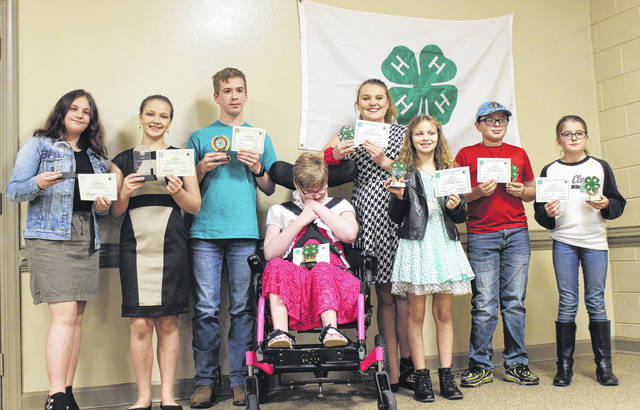 Four-H members are honored for the achievements. Green, Bronze and Silver awards were presented based on different levels.