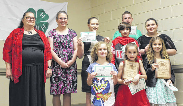 The Hippity Hop 4-H Rabbit Club smile after being honored by Extension Officials. The Hippity Hop Cup Award was also presented during the night.