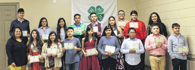 Juntos students from Clinton High School and Sampson Middle School receive recognition for their work in the community.