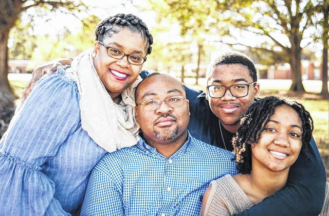 Raymond Hedrick Hayes Jr. is running as a write-in candidate for the Sampson County Board of Education. He is pictured with his wife, Sadora Peterson Hayes; daughter, Zipporah; and son, Raymond.