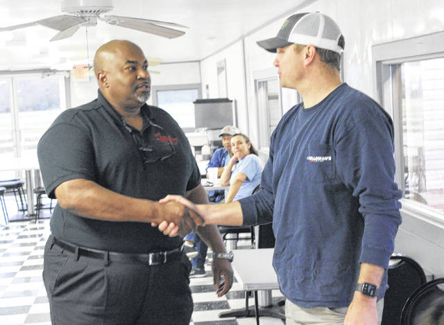 Farmer Josh Coombs meets Mark Robinson, a Republican candidate for North Carolina lieutenant governor. Chase Jordan | Sampson Independent
