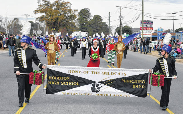 The Hobbton High School Marching Band entertains the crowd during a parade in Newton Grove. The band was selected to represent the state at the 2020 National Memorial Day Parade, and is raising funds for the trip.  File Photo   Sampson Independent