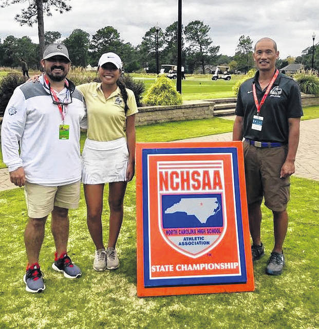 Pictured, from left, are: Head Coach Eddie Gray, Kayla Yang, and assistant coach Ken Yang. Courtesy photo