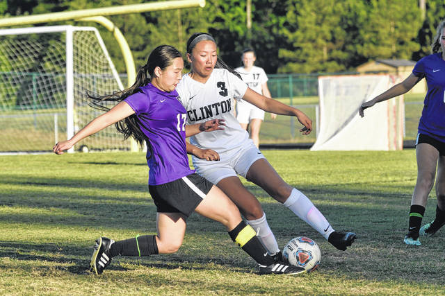 Kayla Yang fights for possession of the ball deep in Clinton territory in a match last year. File Photo | Sampson Independent