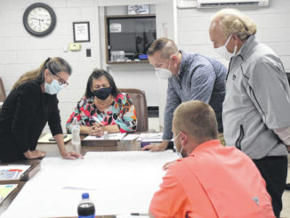 Leaders from the Town of Garland and Star Communications discuss plans for fiber installation.