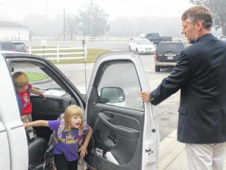 Clement Elementary Principal Matt McLean welcomes students to school.