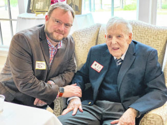 Longtime band leader Ed Taylor spends time with his former student Geoffrey Tart, the director of the Hobbton High School.                                  File Photo|Sampson Independent