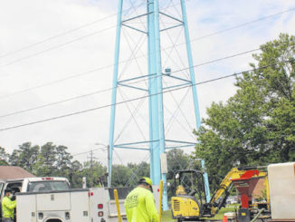 Employees from Den Underground, a subcontractor for Lambert Construction, work with Star Communications to install fiber and improve broadband technology in Garland.