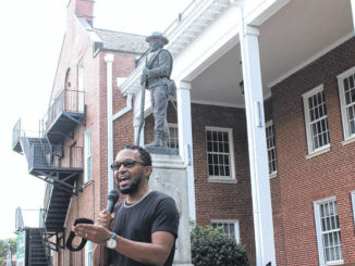 During a peaceful protest Monday, Clinton City Councilman Darue Bryant talks to the public about steps to remove the Confederate monument from the front of the Sampson County Courthouse.