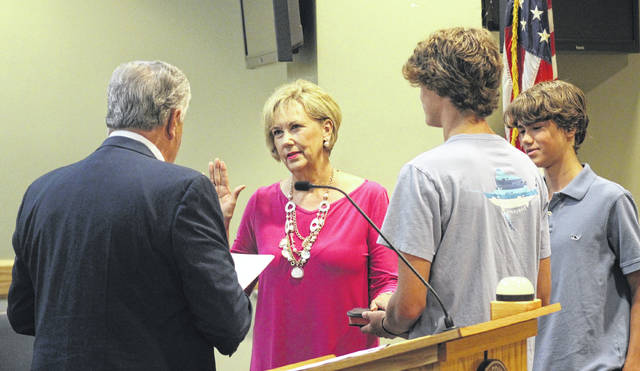 Eleanor N. Bradshaw takes an oath to join the Sampson County Schools Board of Education. During the oath administered by Clerk of Court Chris Fann, she was joined by her grandsons, Loden and Reece Bradshaw.