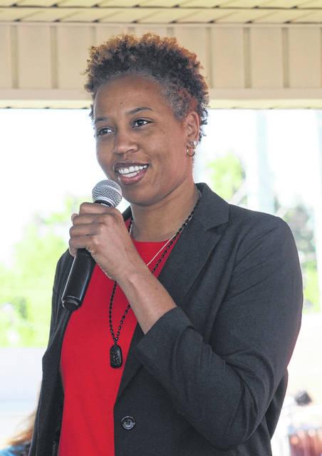<p>During BloomFest in downtown Roseboro, Chasity Melvin speaks to community members.</p>