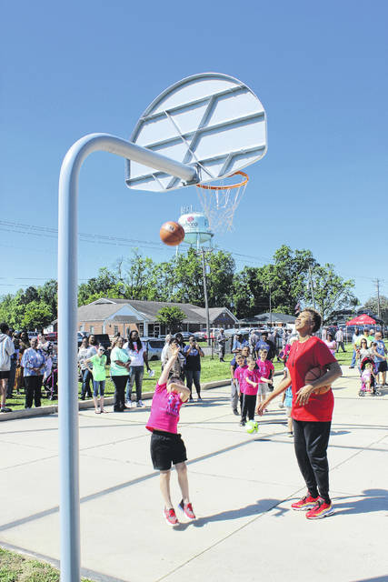 <p>Students from Roseboro Elementary School play basketball with Chasity Melvin following an unveiling of Chasity Court in Roseboro last year.</p>