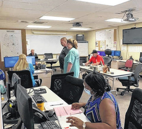 County officials work from within the Sampson County Emergency Operations Center on Sunday.                                  Courtesy photo| County of Sampson