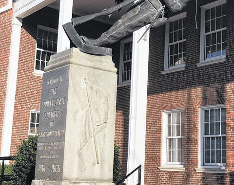 The statue honoring the Confederate soldiers of Sampson County was vandalized last month, in an apparent attempt to pull it off its pedestal. The statue was later removed by county officials, leaving just the base of the monument.                                  File photo|Sampson Independent