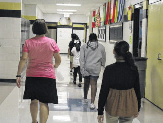 During the Summer School Program, students line up six feet apart to travel to the bathroom.                                  File photo Sampson Independent