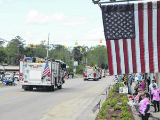 The town's annual Easter procession moves through the heart of Autryville. Commissioners are working to improve infrastructure for residents.