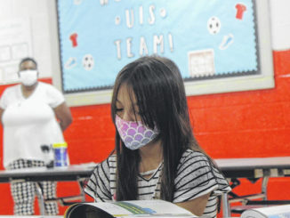 Samantha Zacarias spends time reading during Union Intermediate School's Open House.