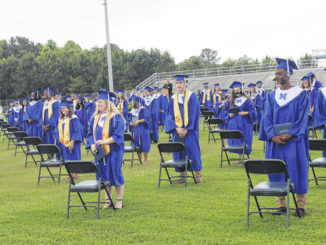 Midway High School graduates face their parents and family after being presented with their diplomas. The school held its graduation ceremony June 11.                                  File Photo|Sampson Independent