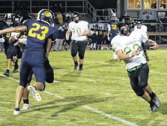 Albert Thornton rounds the corner in a late-game carry for the Crusaders.