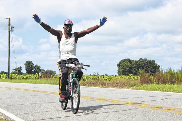 Perry Williams enjoys riding his bike through Sampson County while inspiring others.