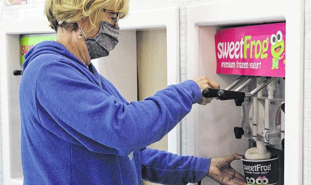 Claudia Davis gets her frozen yogurt.