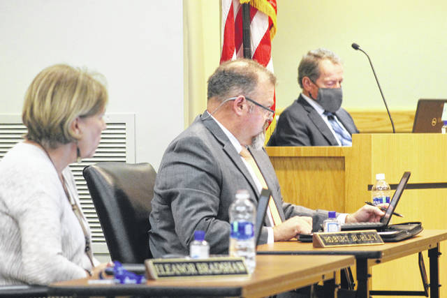 Eleanor Bradshaw and Robert Burley, members of the Sampson County Schools Board of Education, join other members during a Monday meeting.                                  Chase Jordan | Sampson Independent