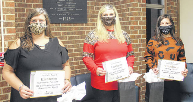 Sampson County Schools recognizes career development coordinators. Pictured from left, Summerlyn Faircloth, Jaclyn Garey, and Shelley Fussell.                                  Chase Jordan | Sampson Independent