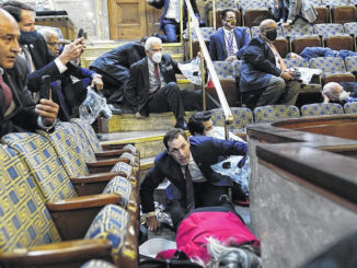 People shelter in the House gallery as protestors try to break into the House Chambers at the U.S. Capitol on Wednesday.                                  AP Photo|Andrew Harnik