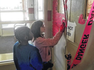 Union Intermediate School students places messages of hope on the gymnasium's closed doors.                                  File Photo | Sampson Independent