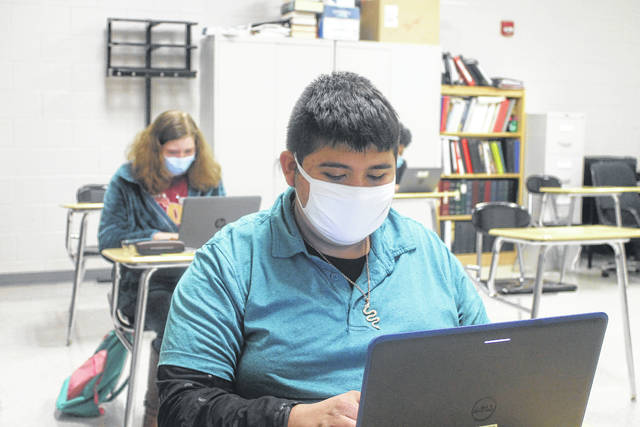 Students from Union High School study with computer devices during class.