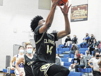 Nick Smith gets two points on a layup during Wednesday's game at Midway.