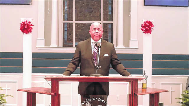 <p>Clinton Mayor Pro-Tem Marcus Becton, president of the Sampson County Interdenominational Ministerial Alliance, lead the 43rd annual Dr. Martin Luther King Jr. Memorial Service.</p>