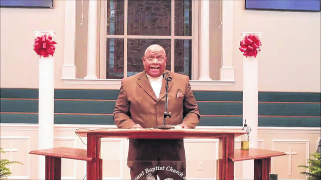 <p>The Rev. Dr. Ronald Highsmith, vice president of the ministerial alliance, read out scripture at the 43rd annual Dr. Martin Luther King Jr. Memorial Service.</p>