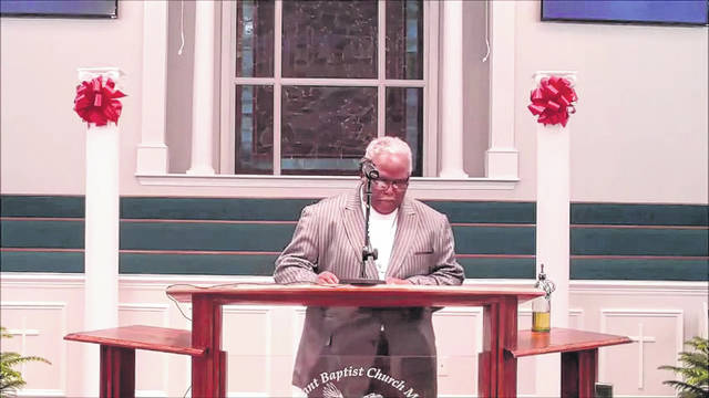 <p>Rev. Dr. Freddie Herring prays at the 43rd annual Dr. Martin Luther King Jr. Memorial Service.</p>