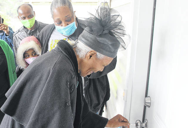 Sandra Taylor smiles while entering her new home on Williams Street, made possible by the Fayetteville Area Habitat for Humanity.                                  Chase Jordan|Sampson Independent