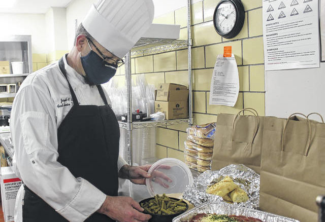 Joseph Hill prepares a meal for a family associated with the Sampson Regional Medical Center.                                  Chase Jordan|Sampson Independent