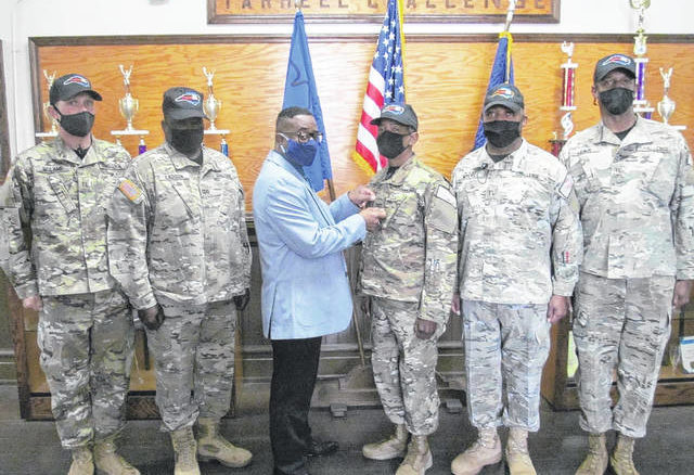 Dwight Robinson, fourth from left, was recently promoted as commandant of the Tarheel ChalleNGe Academy. Also, pictured from left, Brett McLamb, team leader 2; Mark Robinson Cadre, duty officer; Ronnie McNeill, director; Mark Myers, team leader 3; and Ralph Leach, team leader 1.                                  Brenda Newton|Tarheel ChalleNGe Academy