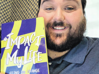 Midway High School and University of Mount Olive alumnus Eric Godwin recently authored a book on social change.