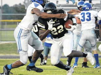"""Davion """"Boogie"""" Smith rumbles for yards during a previous game. The senior will be a key returner for the Horses, who will open up the stands for fans at the home opener next Friday, March 5."""