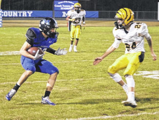 Midway's Thornton Baggett jukes to the left around the defender and scurries down field for his 82-yard touchdown. Baggett had two receiving touchdowns on Friday.
