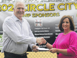 Candace Warren Hobbton Middle PTO Treasurer accepts a donation from Mayor Stephen Jackson. The proceeds came from a baseball camp at Weeks Park.                                  Chase Jordan|Sampson Independent