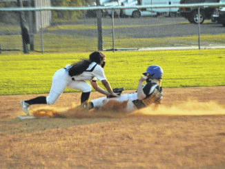 Hobbton's Grace Jones tags a runner at second for an easy out.