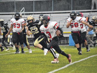 Union's Ethan Johnson scrambles to the outside on a quarterback keeper.