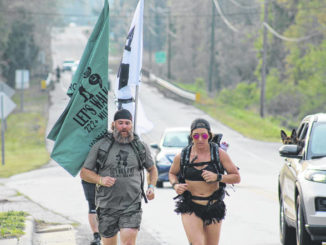 Joey Dalessio and Mari S. jog through Autryville as participants of 'Let's Walk It Out.'                                  Chase Jordan|Sampson Independent