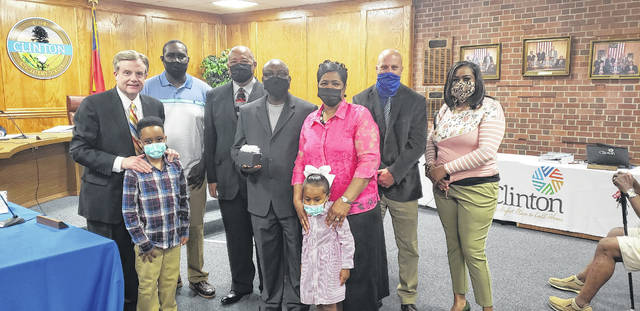 Ray Bolton, center, was recognized at Clinton City Hall on Tuesday night for his retirement after 29 years of service. His family came out in support.