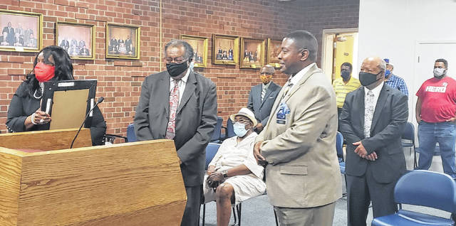 Elaine Faison Hunt, left, was recognized at the recent Clinton City Council for receiving The Order of the Long Leaf Pine. Rep. Larry Bell, center, and Rep. Raymond Smith came to present it to her.                                  Emily M. Williams|Sampson Independent