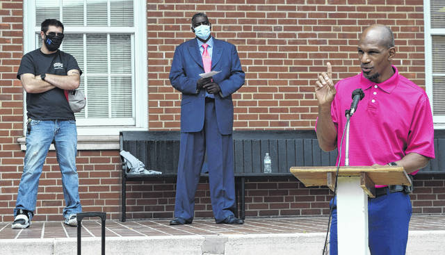 Leonard Henry asked for pastors to be refreshed, restored and revived during the National Day of Prayer observance outside the Sampson County Courthouse in Clinton.                                  Emily M. Williams|Sampson Independent