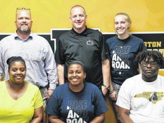 Hobbton volleyball player, Alexis Reid, signed a letter of intent to play volleyball at Penn State University-Beaver, a campus of Penn State University, located in Beaver County, Pa. With her are her mom, Heather Reid and brother Stanley Reid and Principal Michael Warren, as well as Penn State coaches Sean Cleary and Breann King.                                   David Johnson   Sampson Independent